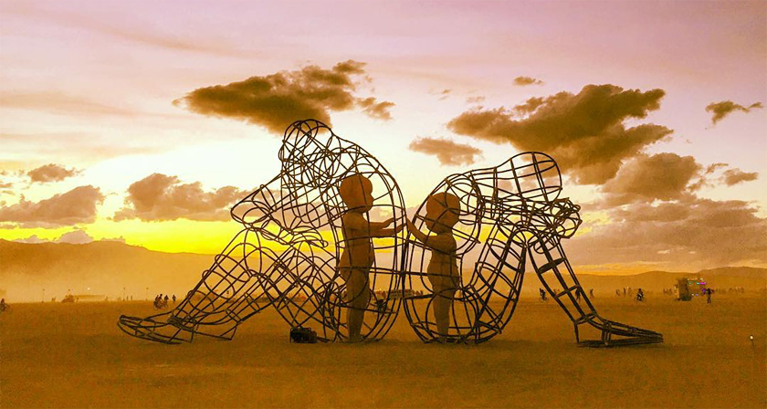 love-inner-child-burning-man-sculpture